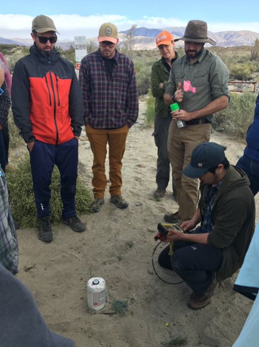 Volunteers gather near Thousand Palms Canyon to listen to a demonstration of how to install and set up the seismic instruments they are about to deploy.
