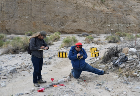 As one team member activates the seismometer, another notes the location and number of the instrument.