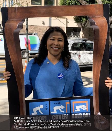 Mayor Breed (San Francisco) holds ShakeOut promo frame